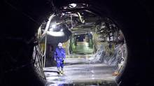 Cameco's Cigar Lake mine manager Rick Forbes walks down one of the mine shafts at the Cigar Lake mine site. Technical analysis shows the uranium producer is set to rise. (David Stobbe/Reuters)