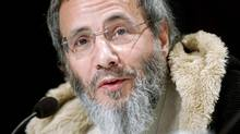 British singer Yusuf Islam, formerly known as Cat Stevens, listens to journalists' questions during a news conference before Monday's Nobel Peace Prize Concert in Oslo December 11, 2006. (LEONHARD FOEGER)