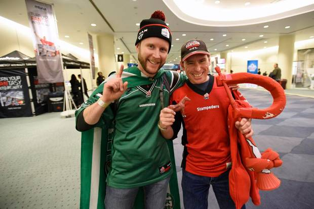 Conrad Brock, left, and his friend Mike Hassel attend Grey Cup fan events at the Metro Toronto Convention Centre on Nov 24 2016. Brock is wearing the colours of the Saskatchewan Roughriders and Mike is wearing Calgary Stampeders colours. The 104th Grey Cup will be played between the Calgary Stampeders and the Ottawa redBlacks this weekend.