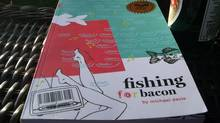 Shantael Sleight sent us this photo of what she's reading: Fishing for Bacon by Michael Davie, recent winner of the $10,000 Alberta Readers Choice Award and the Georges Bugent Award for best novel. (Shantael Sleight/Shantael Sleight)