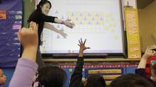 Monica Fong from David Livingstone Elementary works on a SMART board in class in Vancouver, BC, February 29, 2008. (Lyle Stafford for The Globe and Mail/Lyle Stafford for The Globe and Mail)