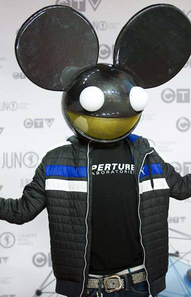 The unmysterious mouse-helmeted musician Deadmau5 perpetuates his Tired5chtick at the Juno Awards in Ottawa on Sunday. (Arthur Mola/AP)