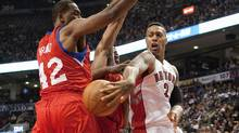 Toronto Raptors' James Johnson (right) plays a pass around Philadelphia 76ers' Thaddeus Young (centre) and Evan Turner (left) during first half NBA basketball action in Toronto on Wednesday April 11 , 2012. (Chris Young/THE CANADIAN PRESS)