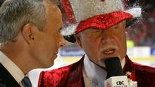 CBC (Canadian Broadcasting Corporation) Sports commentators Ron McLean (left) and Don Cherry (right) comment before Game six of the NHL Stanley Cup Finals between the the Tampa Bay Lightning and the Calgary Flames on June 5, 2004 at Pengrowth Saddledome in Calgary, Canada. The Lightning defeated the Flames in the second overtime 3-2. (Photo by Dave Sandford/Getty Images) (Dave Sandford/2004 Getty Images)
