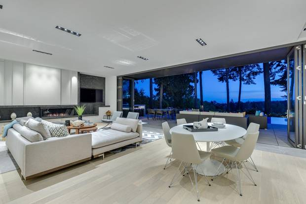 The modern family room opens to the pool area.
