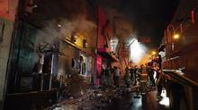 Fire-fighters try to extinguish a fire at Kiss nightclub in the southern city of Santa Maria, 187 miles (301 km) west of the state capital of Porto Alegre, in this picture taken by Agencia RBS, January 27, 2013. At least 200 people were killed in the nightclub fire in southern Brazil on Sunday after a band's pyrotechnics show set the building ablaze, and fleeing patrons were unable to find the emergency exits, local officials said. (STRINGER/BRAZIL/REUTERS)