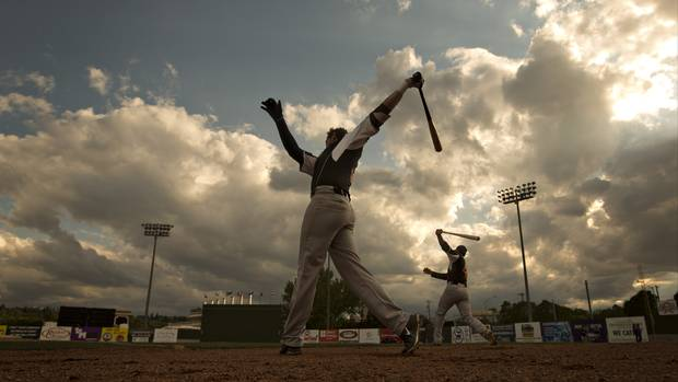 Fort McMurray Giants players warm up before taking on the Edmonton Prospects, in Edmonton Alberta, May 28, 2016. It's the Giants first game in their borrowed stadium since the wildfires in Fort McMurray.
