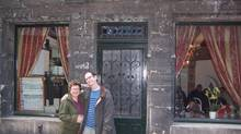 The writer and her husband outside Auberge Nicolas Flamel. (Courtesy of Arlene Stinchcombe)