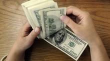 $100 bills (STRINGER/CHINA)