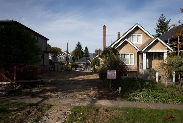 A vacant lot, where a house could be demolished so a new one could be built, is shown in MacKenzie Heights.