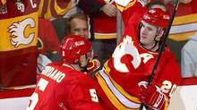 Calgary Flames' Curtis Glencross, right, celebrates his goal against the Edmonton Oilers with teammate Mark Giordano during the second period in Calgary, Alta., on Jan. 26, 2013. (Todd Korol/Reuters)