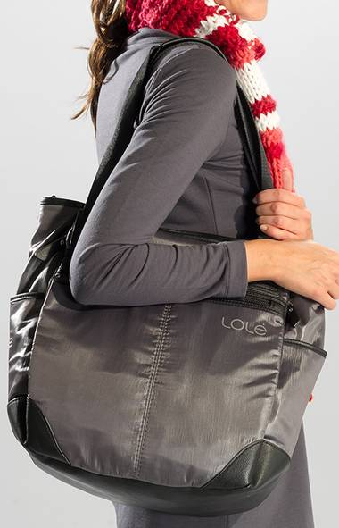 FOR THE QUICK-CHANGE ARTIST: This über organized gym bag from Lolë – the Montreal-based brand fronted by designer Andy Thê-Anh – has separate compartments for her shoes, phone and laptop, plus a detachable cosmetics bag. Lolë Lily Tote Bag, $120, lolewomen.com