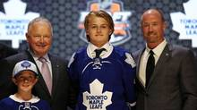 William Nylander poses for a photo with team officials after being selected as the number eight overall pick to the Toronto Maple Leafs in the first round of the 2014 NHL Draft at Wells Fargo Center. (Bill Streicher/USA Today Sports)