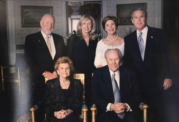 Peter Pocklington and his wife Eva are pictured with former US President Gerald Ford and his wife Betty and George W. Bush and his wife Laura in this undated photo on display at his Palm Springs, California home in June 2017.