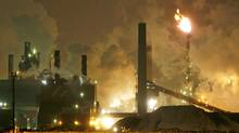 Waste gases burn as smoke and steam belch from steel mills in Hamilton on February 1, 2007. (J.P. MOCZULSKI)