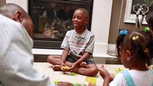 Mekhi Rutherford plays with his family in their home Aug. 18 in Markham, Ontario. Mekhi will be attending the full-day senior kindergarten class at Ellen Fairclough Public School this year. (Anne-Marie Jackson/ The Globe and Mail/Anne-Marie Jackson/ The Globe and Mail)