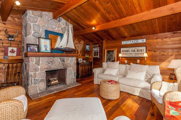 The one-storey cottage includes a field stone fireplace.