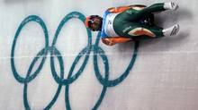 In this Feb. 10, 2010 file photo, Shiva Keshavan, of India, takes a practice run during the men's singles luge training session at the Vancouver 2010 Olympics in Whistler, British Columbia. (Michael Sohn/AP)