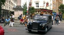 A London taxi makes its way around the Seven Dials roundabout at Covent Garden in London. (Ben Hamilton-Baillie)