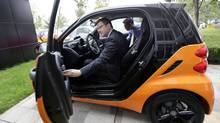 Mercedes-Benz China President and CEO Klaus Maier adjusts the car window of a Smart car during an interview with Reuters in Beijing July 14, 2011. (Jason Lee/Reuters/Jason Lee/Reuters)