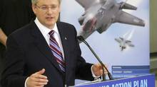 Prime Minister Stephen Harper speaks to employees, at Virtek Vision International Inc. in Waterloo, Ont. Prime Minister Harper toured the high-tech facility, which deals with lasers and manufacturing the materials used in the new F35 fighter jet. (FRED THORNHILL/REUTERS)