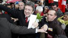 Jean-Luc Melenchon, left, leader of France's Parti de Gauche political party and the Front de Gauche political party's candidate for the 2012 French presidential election, arrives during a campaign visit to Pau on April 15. (Marc Zirnhel/Reuters/Marc Zirnhel/Reuters)