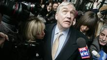 Convicted newspaper baron Conrad Black leaves the federal building in Chicago Monday, Dec. 10, 2007, after sentencing in his racketeering and fraud trial. Black, convicted July 13 of swindling the Hollinger International newspaper empire he once ran out of millions of dollars, was sentenced to 78 months in prison. (Jerry Lia/Jerry Lia/AP Photo)