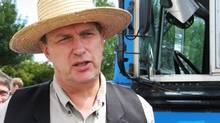 Farmer Michael Schmidt, shown in 2008, has repeatedly said he believes raw milk is not only safe, but offers health benefits as well. (COLIN PERKEL/THE CANADIAN PRESS)