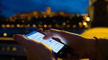 A Samsung Electronics Co. Ltd. smartphone is seen illuminated during use near the River Danube in this arranged photograph in Budapest, Hungary, on April 23, 2012. (Akos Stiller/Bloomberg)