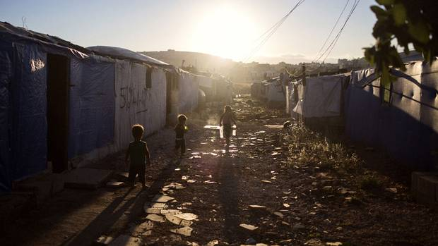 A group of children play at an informal tented settlement in Beeka, Lebanon in July 2015, Lebanon.