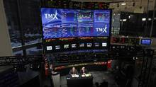 London Stock Exchange CEO Xavier Rolet, left, and TMX Group CEO Tom Kloet speak to the media at the TMX Broadcast centre. (Mark Blinch/Reuters/Mark Blinch/Reuters)