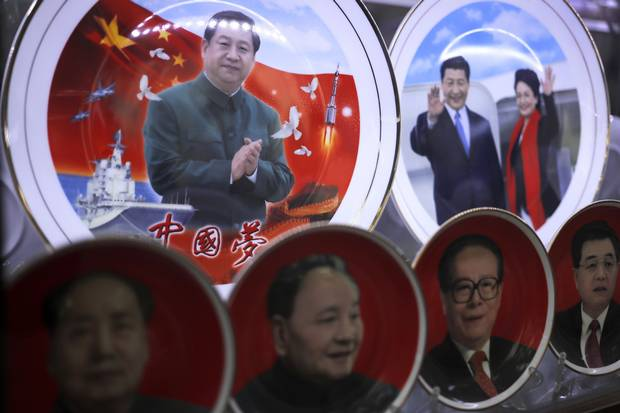 Porcelain plates with images of Chinese President Xi Jinping and his wife, Peng Liyuan, are displayed at a souvenir shop near Tiananmen Square. Below are previous Chinese leaders Mao Zedong, Deng Xiaoping, Jiang Zemin and Hu Jintao.