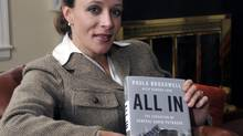 Paula Broadwell with a copy of the biography she co-authored of David Petraeus. (T. Ortega Gaines/AP)