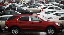 Newly built cars sit in a shipping lot near General Motors car assembly plant in Oshawa in this June 1, 2012, file photo. (Mark Blinch/Reuters)