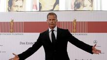 Til Schweiger poses on the red carpet as he arrives for the German Film Prize 'Lola' award ceremony in Berlin, April 25, 2008. (Tobias Schwarz / Reuters/Tobias Schwarz / REUTERS)