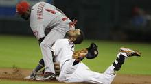 Houston Astros shortstop Jonathan Villar is out at second base as Cincinnati Reds second baseman Brandon Phillips reaches back for the tag (Melissa Phillip/Associated Press)