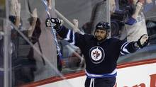 Winnipeg Jets' Dustin Byfuglien (33) celebrates the game winning goal in overtime against the Carolina Hurricanes in NHL action in Winnipeg on Thursday, April 18, 2013. (JOHN WOODS/THE CANADIAN PRESS)