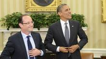 U.S. President Barack Obama (R) and French President Francois Hollande button their jackets following their bilateral meeting in the Oval Office of the White House in Washington May 18, 2012. (REUTERS)