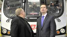 Toronto Mayor Rob Ford looks back at cameramen on a subway cars as Ontario Premier Dalton McGuinty looks forward at another line of cameras following a joint transit funding announcement at the Wilson car yard in Toronto, March 31, 2011. (J.P. Moczulski/The Globe and Mail/J.P. Moczulski/The Globe and Mail)