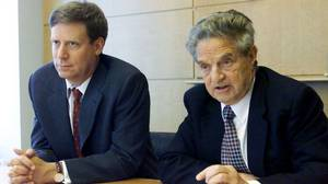 Stanley Druckenmiller (L) speaks at a news conference in New York with George Soros (R).