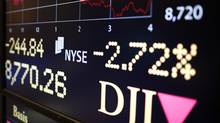 An electronic sign shows the Dow Jones Industrial Average at the New York Stock Exchange. (MIKE SEGAR/REUTERS)