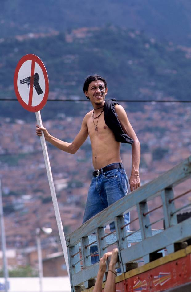 Protestor against small arms during a peace demonstration in the Colombian city of Medellin, Antioquia, 2002. The International Action Network on Small Arms (IANSA), a global movement against gun violence estimate that 300,000 to half a million people around the world are killed by small arms each year.