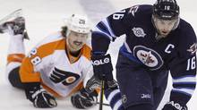 Winnipeg Jets' Andrew Ladd (16) skates around Philadelphia Flyers' Claude Giroux (28) during the second period of NHL action at MTS Centre in Winnipeg, Saturday, November 19, 2011. THE CANADIAN PRESS/Trevor Hagan (Trevor Hagan/CP)