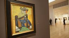 Pablo Picasso's painting Femme Assise Dans Un Fauteuil hangs as part of a collection of Impressionist and Modern Art to be auctioned off May 2, at Sotheby's auction house in New York. (LEE CELANO/LEE CELANO/REUTERS)