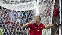 Canada's captain Kevin McKenna reacts to missing a late scoring scoring opportunity during the second half of his team's goal less tie with Honduras' in CONCACAF World Cup qualifying action in Toronto on Tuesday June 12 , 2012. (Chris Young/THE CANADIAN PRESS)