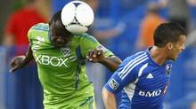 Seattle Sounders FC defender Jhon Kennedy Hurtado (34) fights for the ball against Montreal Impact midfielder Felipe Martins (7) during the first half of their MLS soccer match in Montreal, June 16, 2012. (Reuters)