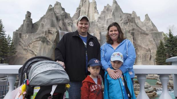 Season pass holders (rear left) Evan White, 37, a steamfitter, Heather White, 33, an educational assistant, with (front left) Danny White, 3, and Jack White, 6, from Newmarket, pose for a portrait at Canada's Wonderland amusement park in Vaughan, Ont., May 11, 2013. (Philip Cheung For The Globe and Mail)