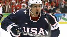 Zach Parise of the U.S. celebrates after scoring a goal against Canada to go into overtime in the last thirty seconds of the third period in their men's ice hockey gold medal game at the Vancouver 2010 Winter Olympics February 28, 2010. (SCOTT AUDETTE/REUTERS)