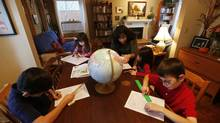 Karen Reinberg-Abernethy works with her children Gabriel, Serena, Victoria and Sebastian, who are all home schooled in Calgary, Nov. 12, 2012. (Todd Korol For the Globe and Mail)