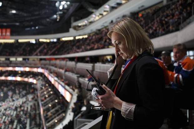 Rogers Place vice president and general manager Susan Darrington keeps in contact with her team while inspecting the arena before an Edmonton Oilers pre-season game in Edmonton, Alta., on Tuesday, Oct. 4, 2016.